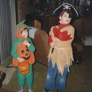 Halloween 1989. I went as a pirate, and Sis went as a pumpkin.