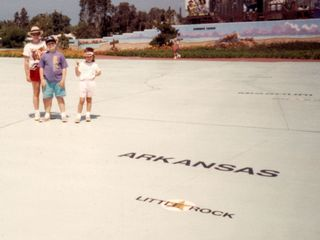 A giant map of the United States is spread out before us... so Mom, Sis, and myself got our picture taken while standing on Rogers, Arkansas.