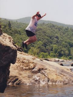 On a church tubing trip on the James River around 1998, I am shown here jumping off a rock into the water.