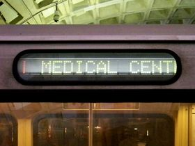 "Destination signs: 1000-Series destination signs are ""flip-dot"".  The sign window is slightly narrower than the sign itself.  Due to this narrower width, for longer destination names, such as New Carrollton, Silver Spring, or in this case, Medical Center, the final letter is obscured."