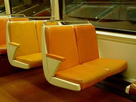 Seats: The 1000-Series is the only series where the car interior has tan walls and metal handrails on the backs of the seats.