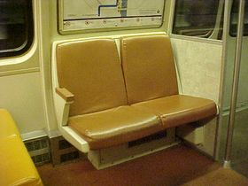 Side-facing seats: The 1000-Series has extra sideways-facing seating around the end doors, including underneath the maps.  In other car series, this area is used for additional standing room.