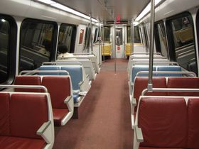 "Seats: 2000 and 3000-Series cars' seats have the color scheme of ""Potomac Blue"", ""Colonial Burgundy"", and ""Chesapeake Sand"", have white walls, and have metal handrails on the backs of the seats."