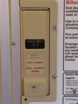Emergency door release: The emergency door release on the 4000-Series cars is flush with the wall, tan in color, and has a tan label with red lettering.