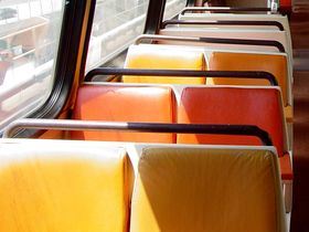 Seats: With the exception of a single car pair, 4000-Series cars have orange seats with brown rubber handrails.  The 4000-Series is the only car type that has rubber handrails instead of metal.