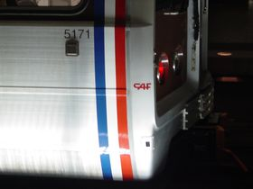"Builder's mark: 5000-Series cars have a ""CAF"" marking on the exterior of the car next to the vertical striping, approximately eighteen inches lower than the cab window."