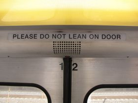"Door signage: The 5000-Series has slightly different door signage, reading, ""Please do not lean on door"", with ""door"" in singular form, as compared to the plural ""Please do not lean on doors"" on other car types."