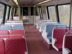 Interior: The 5000-Series has an interior layout identical to that of the 2000, 3000, and 4000-Series cars, white walls, and a pinkish carpet.