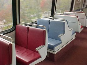 "Seats: The seats on 5000-Series cars follow the ""Potomac Blue"", ""Colonial Burgundy"", and ""Chesapeake Sand"" color scheme, and have metal handrails on the seat backs."