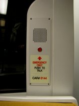 Emergency intercoms: The emergency intercoms at the ends of the cars on the 6000-Series are located next to the door frame for the bulkhead door, rather than on the door frame as in other car types.
