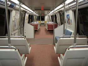 Interior: The 6000-Series has a different layout from other car types in an effort to improve passenger flow. There are no windscreens, only two pairs of side-facing seats at the center of the car, a double handrail along the ceiling, and more seat-back-to-ceiling poles.