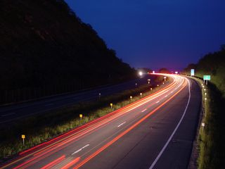 The headlights and taillights of cars and trucks on Interstate 64 light the way in these views east on Afton Mountain, towards Albemarle County.
