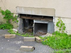 Opening into a basement or crawlspace beneath the main level of the restaurant.