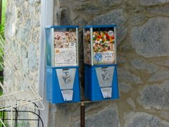Candy dispensing machines, likely untouched since the restaurant's closure in 1998. Note the faded colors of the candies contained within.