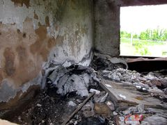 Interior of one guest room, showing extensive fire damage.