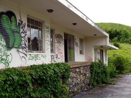 Guest building covered in graffiti.