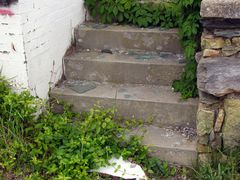 Broken glass litters the steps up to the guest rooms.