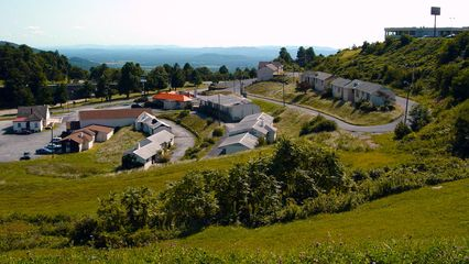This birds-eye view of the area was taken from a gravel area along the access road to The Inn at Afton. From top right to bottom left, you have The Inn at Afton, the Skyline Parkway Motel (brown buildings), the Skyline Parkway Motor Court (white buildings), Howard Johnson's Restaurant (orange roof), the Tourist Information Center (brown roof), and a building that once housed a gift shop (far left).