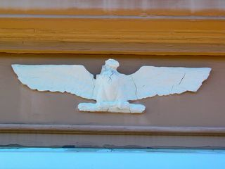 This eagle with wings outstretched has stood over the entrance since the restaurant first opened, though now its details have been masked by many layers of paint.