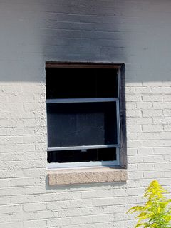 The third room from the right (as seen from the front) appeared to have experienced a fire in it at some point, and the damage was never repaired. That particular room showed smoke damage around the exterior of the back side window. In front, this room had no curtains, and had a higher number of broken windows than most rooms.