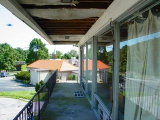However, original or not, it had still decayed considerably, in this case due to the roof's being in poor shape, which caused considerable damage. Additionally, the sidewalk in front of these rooms had settled to the point where it was noticeable that the sidewalk was slanted.