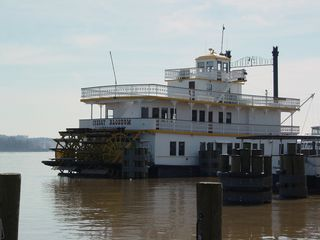 Along the waterfront, there are also a number of boats for quick pleasure cruises. This boat is called the Cherry Blossom.