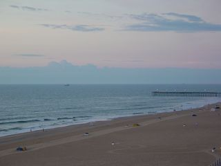 The lights are still on at the fishing pier, as the clouds continue to hide the fun from us.