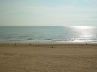 The sun is fully up and daylight has arrived, and except for a swath near the middle, the beach has been combed smooth.