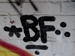 """As you can see, the room was tagged all over the place, with Borf, """"Cert"""", and others taking prominent places in the display."""