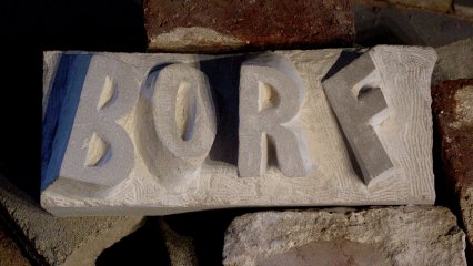 """On the floor across from the tagging scene, this cast of """"BORF"""" lay amongst a pile of bricks."""