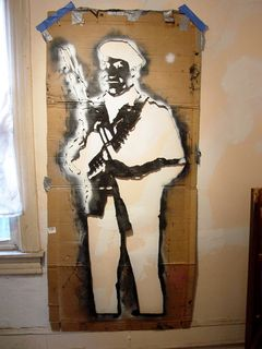 This stencil featured the grinning Borf face on the body of Black Panther Huey P. Newton holding a rifle.