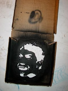 The Borf face itself was cut out of the bottom of a pizza box. An inspection of the box revealed no specific brand. I was surprised to see that a pizza box was the stencil, but then again, I wasn't quite sure what to expect about such things.