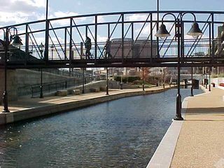 """Quaint """"retro"""" bridges are a regular feature in this """"beginning"""" end of the Canal Walk."""