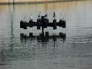 An interesting light fixture sits in the middle of a wider part of the Canal.