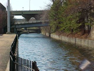 At this point, the Canal Walk becomes less retro, and becomes more functional, as more modernist fittings, such as the lower of the two bridges in the picture above, replace the more retro-style footbridges of previously.