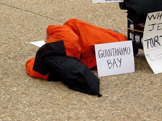 """One participant laid on their side for a time, which made for quite a dramatic appearance, with the """"Guantanamo Bay"""" sign prominently displayed."""