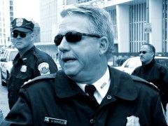 Captain Jeff Herold of the Metropolitan Police Department, speaking with demonstrators