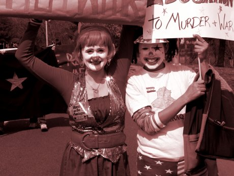 Two women demonstrate in clown makeup