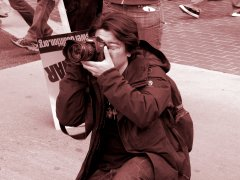 A man photographs the events in Crystal City