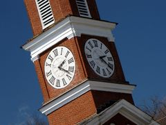 Clock faces on the steeple of Town Clock Church.