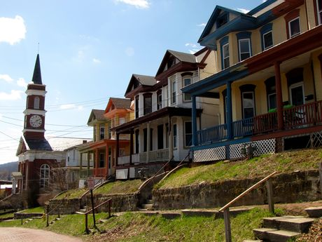 Colorfully-painted houses along Bedford Street, up the street from Town Clock Church.