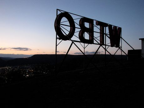 View of Cumberland from behind the WTBO sign, on Wills Mountain, at sunset.