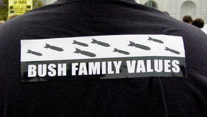 """One person took a bumper sticker and plastered it across their back, making a statement about """"Bush Family Values""""."""