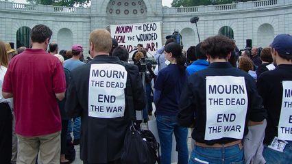 A significant crowd had gathered to hear the speeches and participate in the march. Note the signs on the backs of some participants. These were given out by the people organizing the protest, and pinned on the participants' backs. It really made for a powerful statement, since the message was in large type and in black and white.