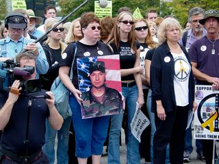 One woman near the front of the group held up a large photo of a soldier killed in Iraq.
