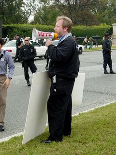 """Using various sound equipment, the counter-protesters chanted, """"Protect the kids from car bombs, like you did for Saddam! Where are the human shields?"""""""