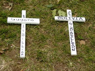 Additionally, small wooden crosses were placed all over the ground, each with the name of a third world country, and the amount of their debt.