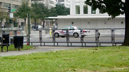 The area around the World Bank was barricaded off, creating a secure zone going a number of blocks in all directions. Murrow Park was about the only way that anyone could actually see the World Bank building, and the park itself was barricaded on three sides. On one side, the barricades extended as far away as Farragut Square, where a vehicle access gate was set up.