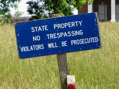 Sign warning unauthorized individuals not to enter the property