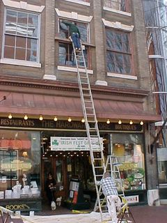 Seems that maintenance work is going on at The Hardware Store... Seems they're repainting window frames. The new color definitely works!